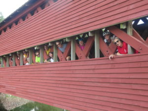 Guests peeking out of Sachs Covered Bridge