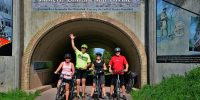 Cyclists Bike Touring the Great Allegheny Passage bike trail and passing through the Eastern Continental Divide with Wilderness Voyageurs Bike Tours